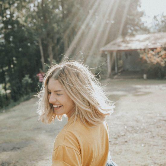A woman shining under sunlight