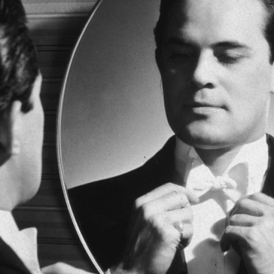 A narcissist checking himself out in a mirror