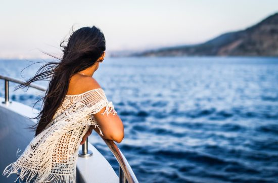A wife on a ship overlooking beautiful waters and considering jumping ship