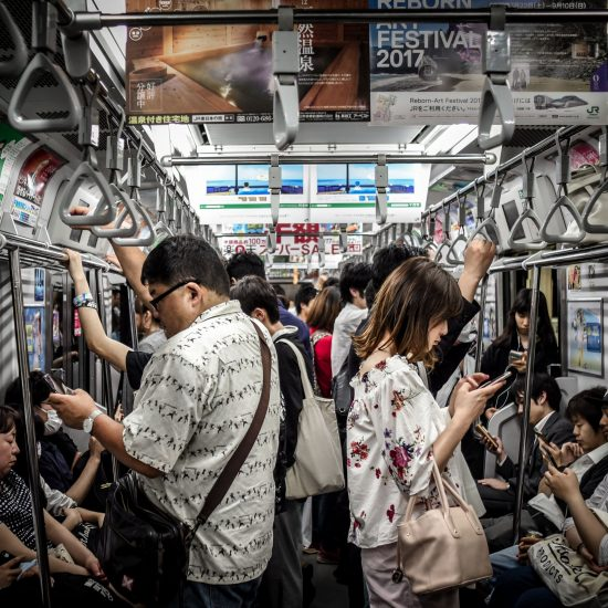 People on a Japanese train consumed by their smartphone