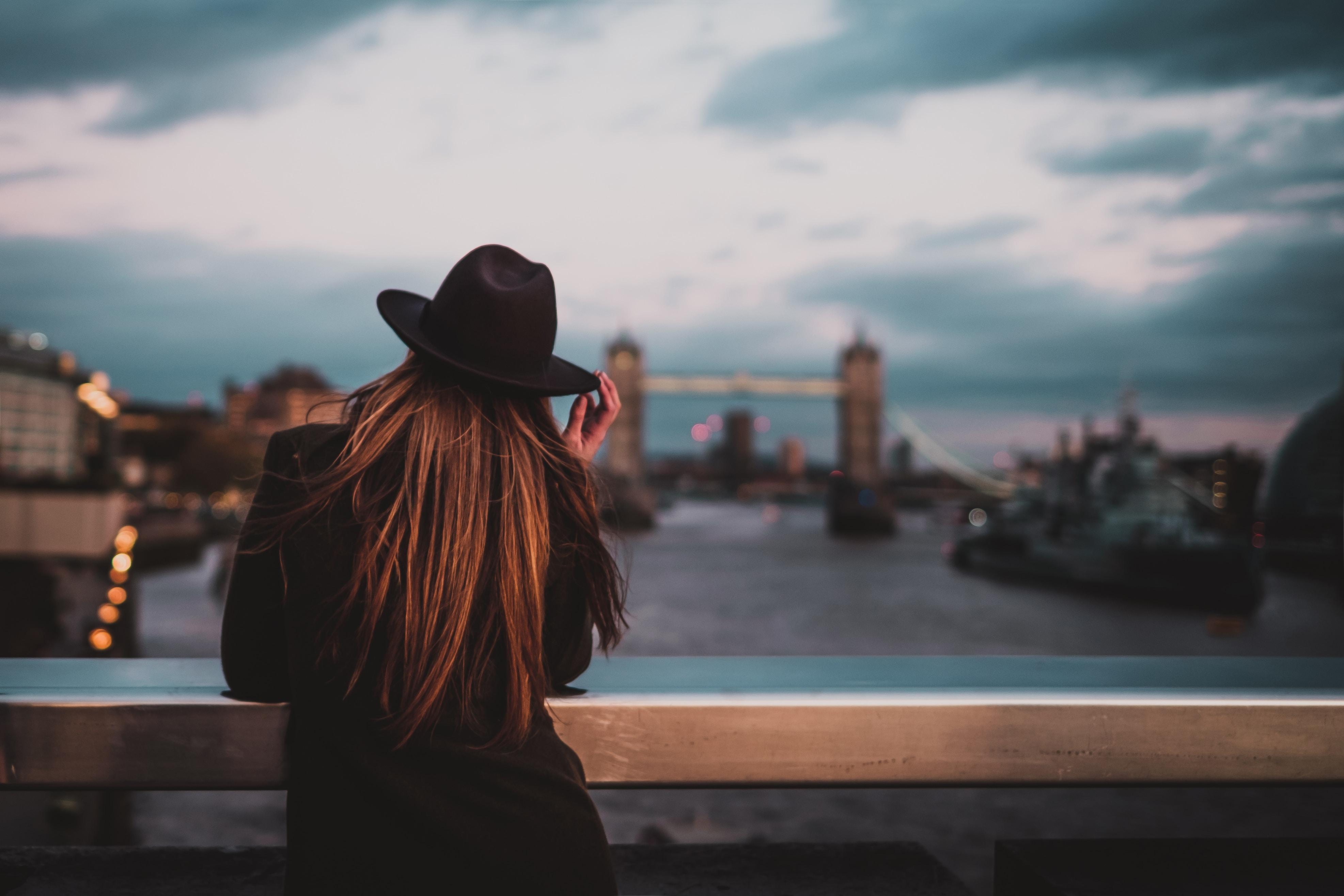 A single woman in London looking at the London Bridge