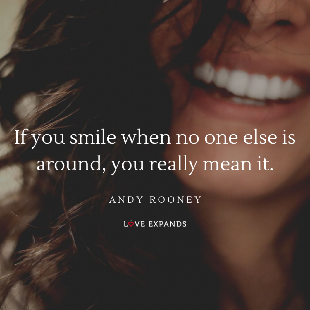 """A picture quote by Andy Rooney of a woman's beautiful smile. The quote reads, """"If you smile when no one else is around, you really mean it."""""""