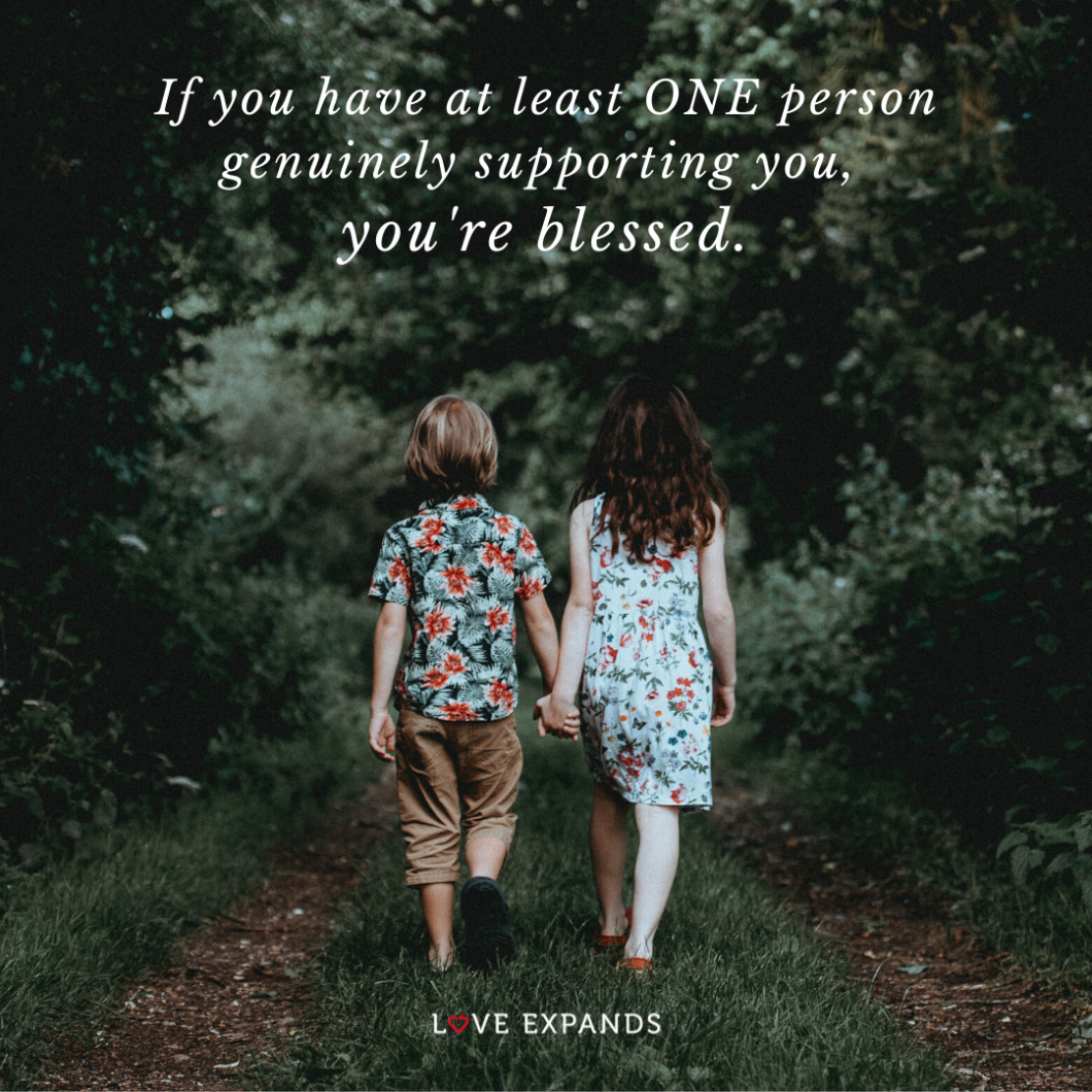 Two kids holding hands while walking in the woods. Picture quote: If you have at least ONE person genuinely supporting you, you're blessed.