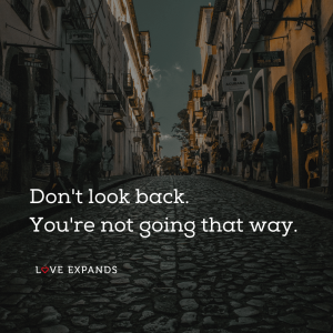 "Picture quote of a city street: ""Don't look back. You're not going that way."""