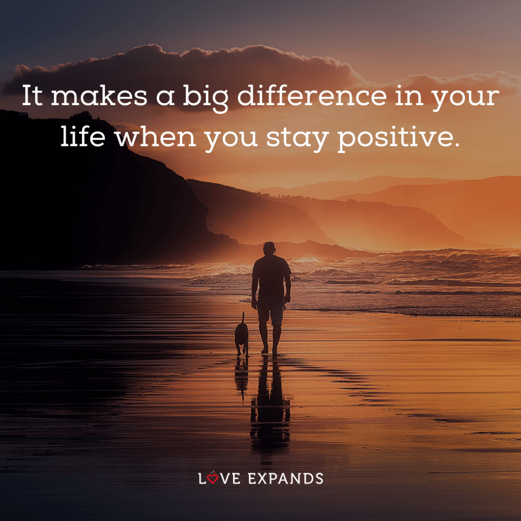 """Picture quote of a man and dog walking on the beach: """"It makes a big difference in your life when you stay positive."""""""