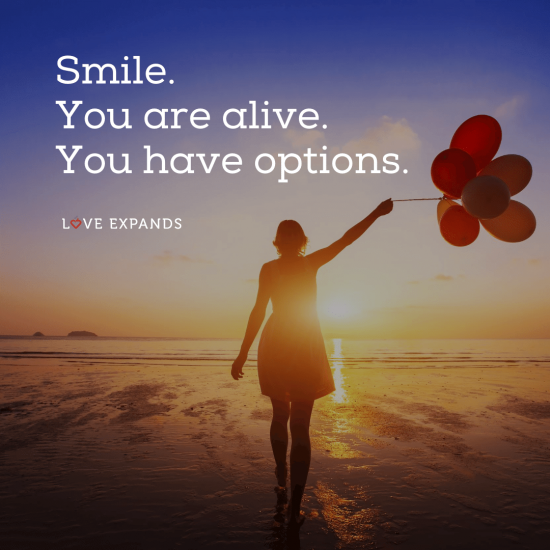 "Picture quote of a woman walking on the beach with balloons in hand: ""Smile. You are alive. You have options."""