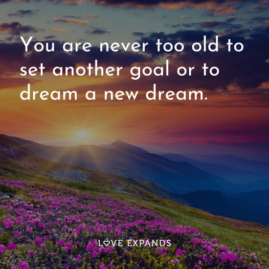 "Dreamy picture quote of prairie, mountain and sun: ""You are never too old to set another goal or to dream a new dream."""