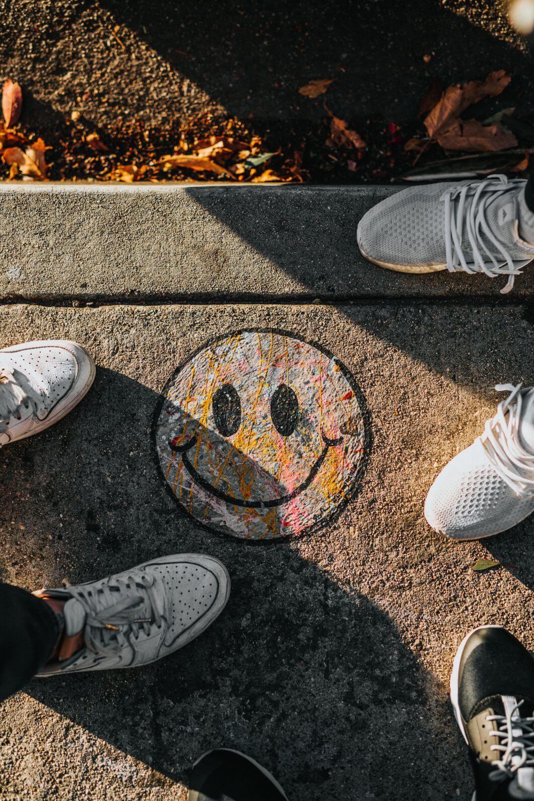 Crayon drawing of a positive, smiley face in playground.