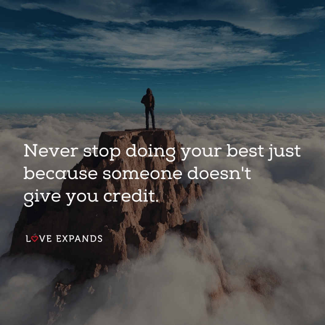 """A man standing on a mountain top above clouds: """"Never stop doing your best just because someone doesn't give you credit."""""""