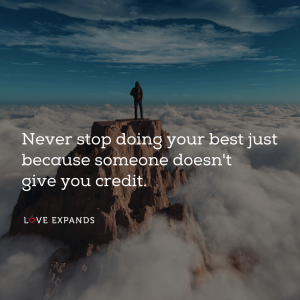 "A man standing on a mountain top above clouds: ""Never stop doing your best just because someone doesn't give you credit."""