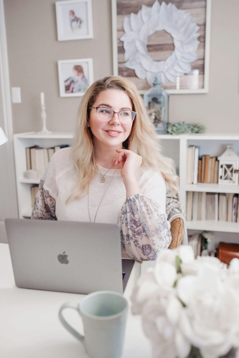 A smiling woman boosting her mindfulness while working from home