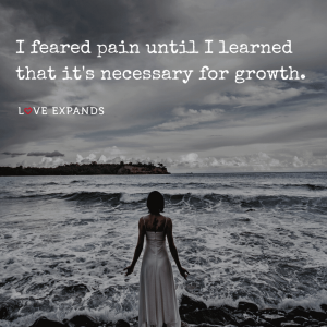 "Picture quote of a woman facing stormy seas: ""I feared pain until I learned that it's necessary for growth."""