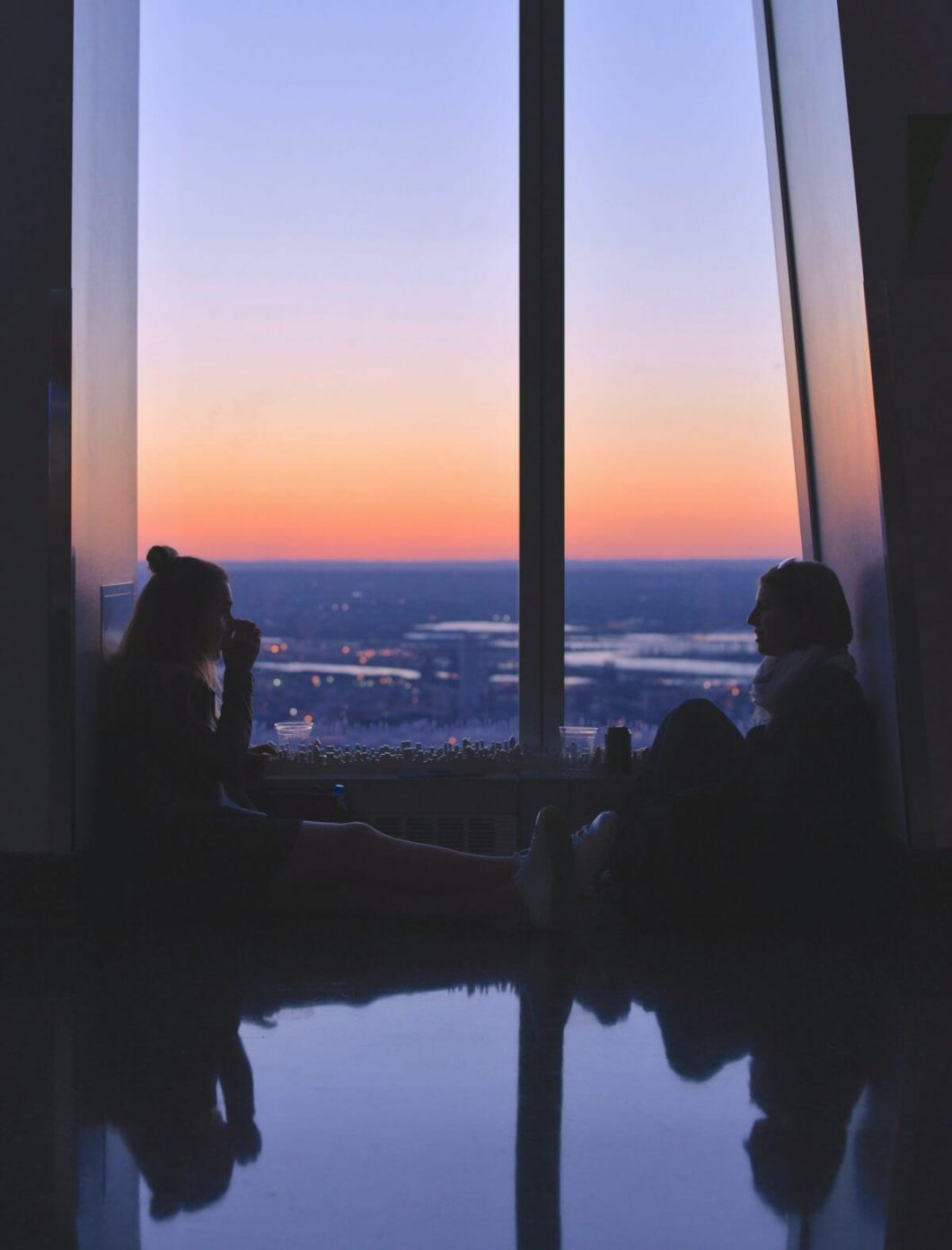 Two women sitting by a window, strengthening their Emotional Intelligence (EQ)