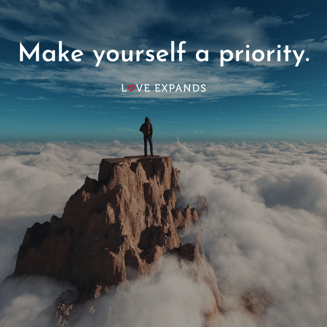 """Standing tall on a mountain top picture quote: """"Make yourself a priority."""""""