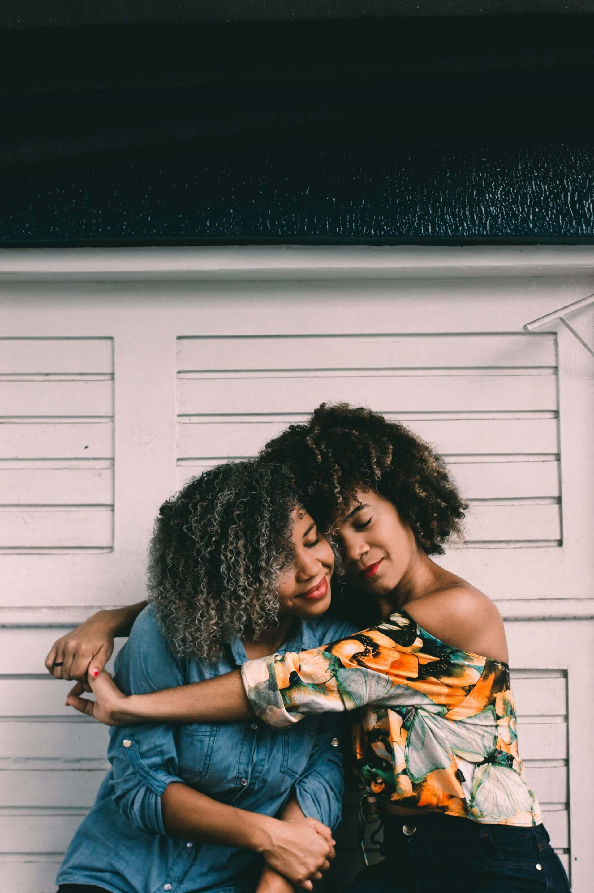 Two black women hugging and displaying gratitude for their friendship