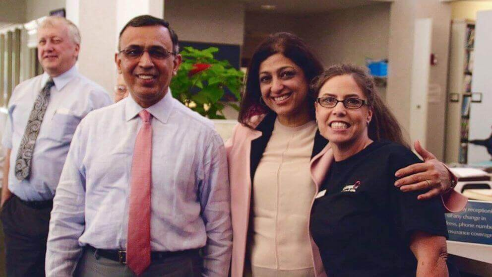 Dr. Omar Atiq, far left, an oncologist, standing next to his wife Mehreen, forgave his patients around $650,000 medical debt.