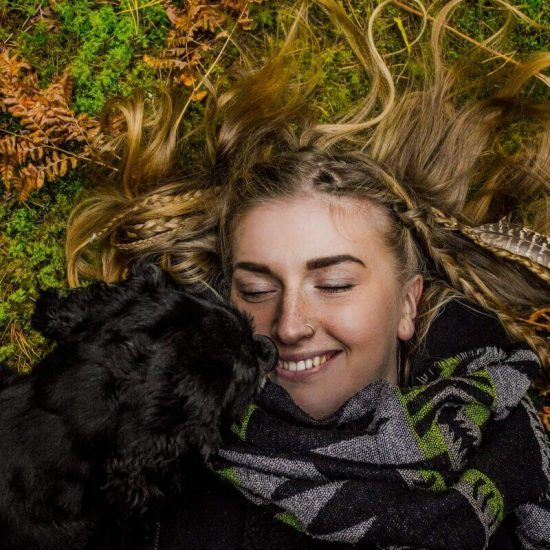 A young lady and her puppy living a moment of abundance and gratitude.