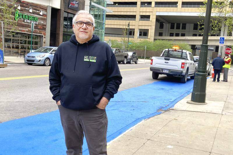 Tony Sacco, co-owner of Mootz Pizzeria and Bar in Detroit, stands on Library Street near his restaurant