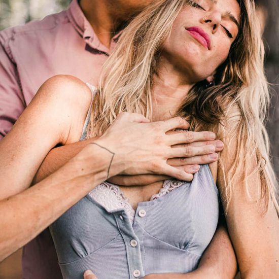 A hugging man and woman who are in an unhealthy codependent relationship