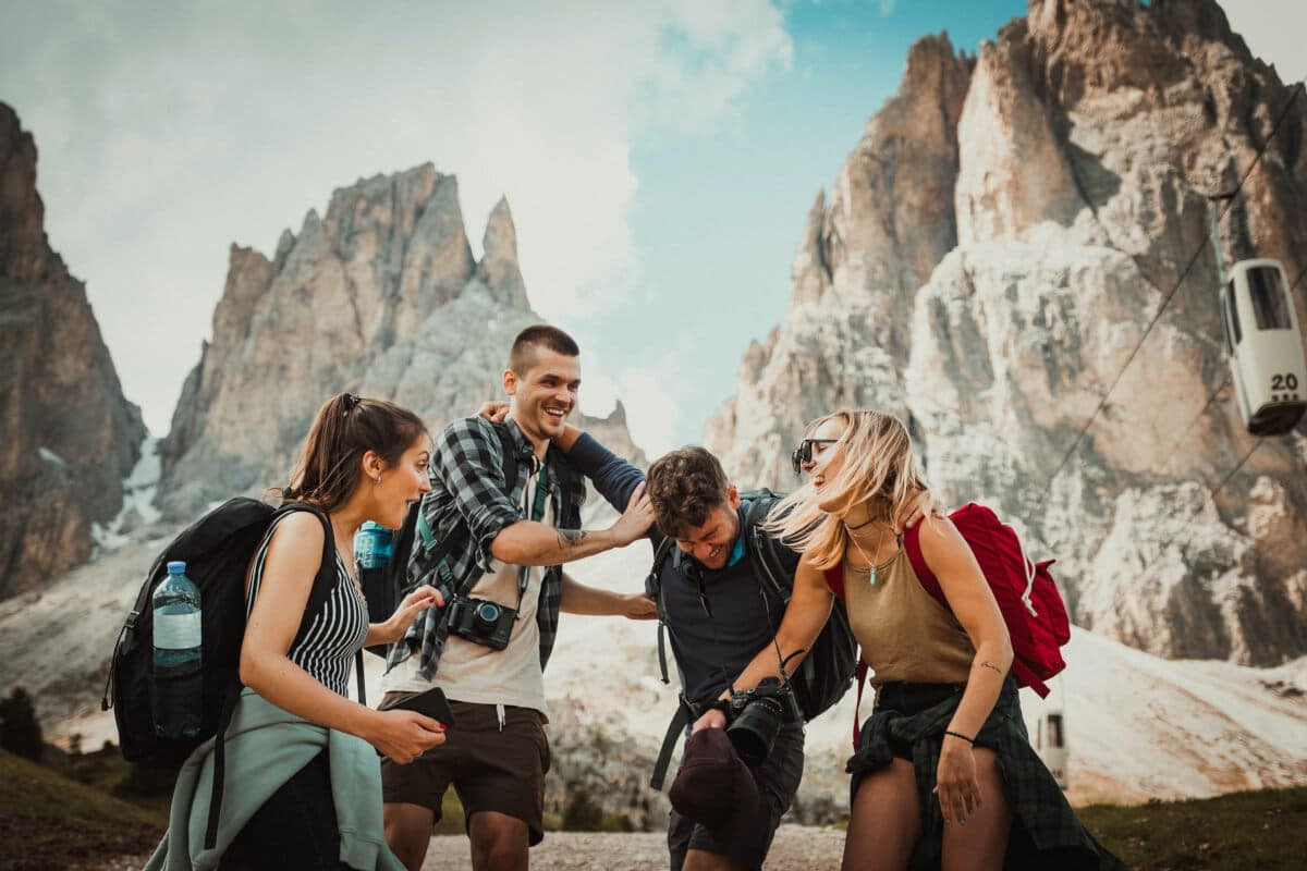 A happy group of rock climbing friends laughing