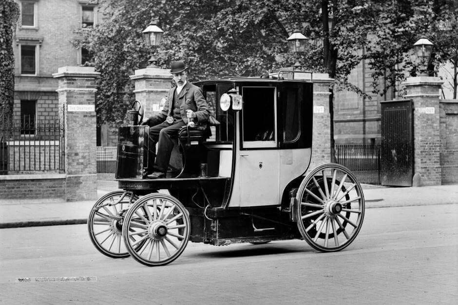 Walter Arnold driving a horseless carriage