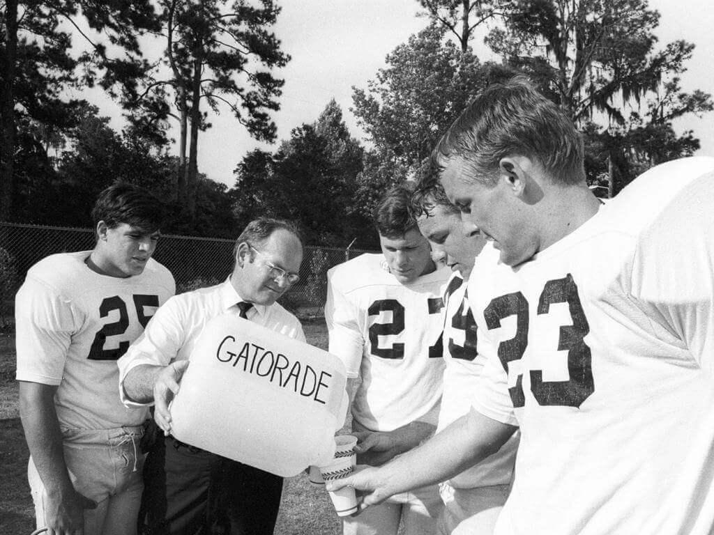 Florida Gators football head coach Ray Graves giving his player Gatorade