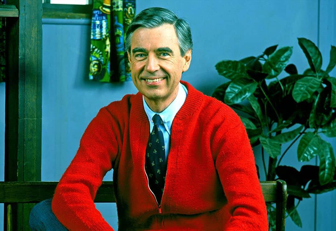 Mister Rogers wearing a red sweater that was knit by his mother