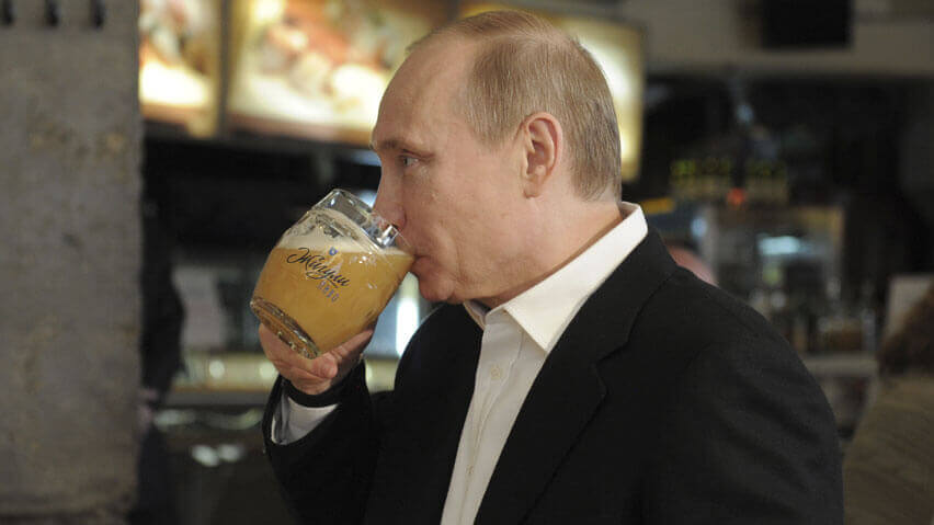 A fun picture of President Vladimir Putin of Russia drinking a beer