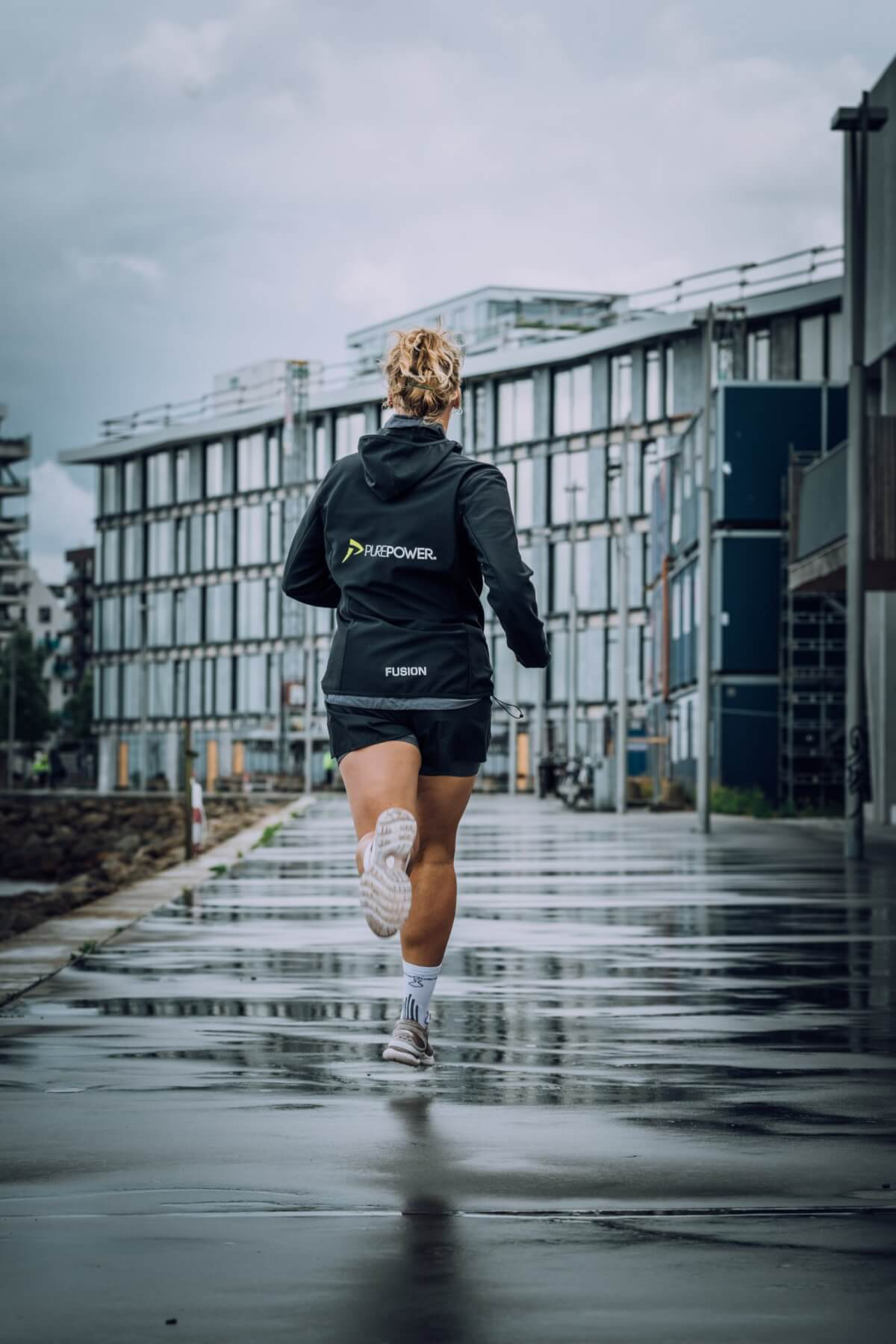 A woman jogging and taking responsibility to get in better shape