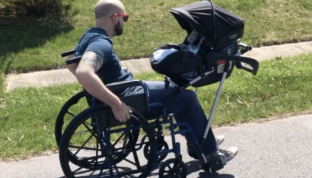 A group of 10 high school students made it possible for a father with impaired mobility to walk with his newborn son.