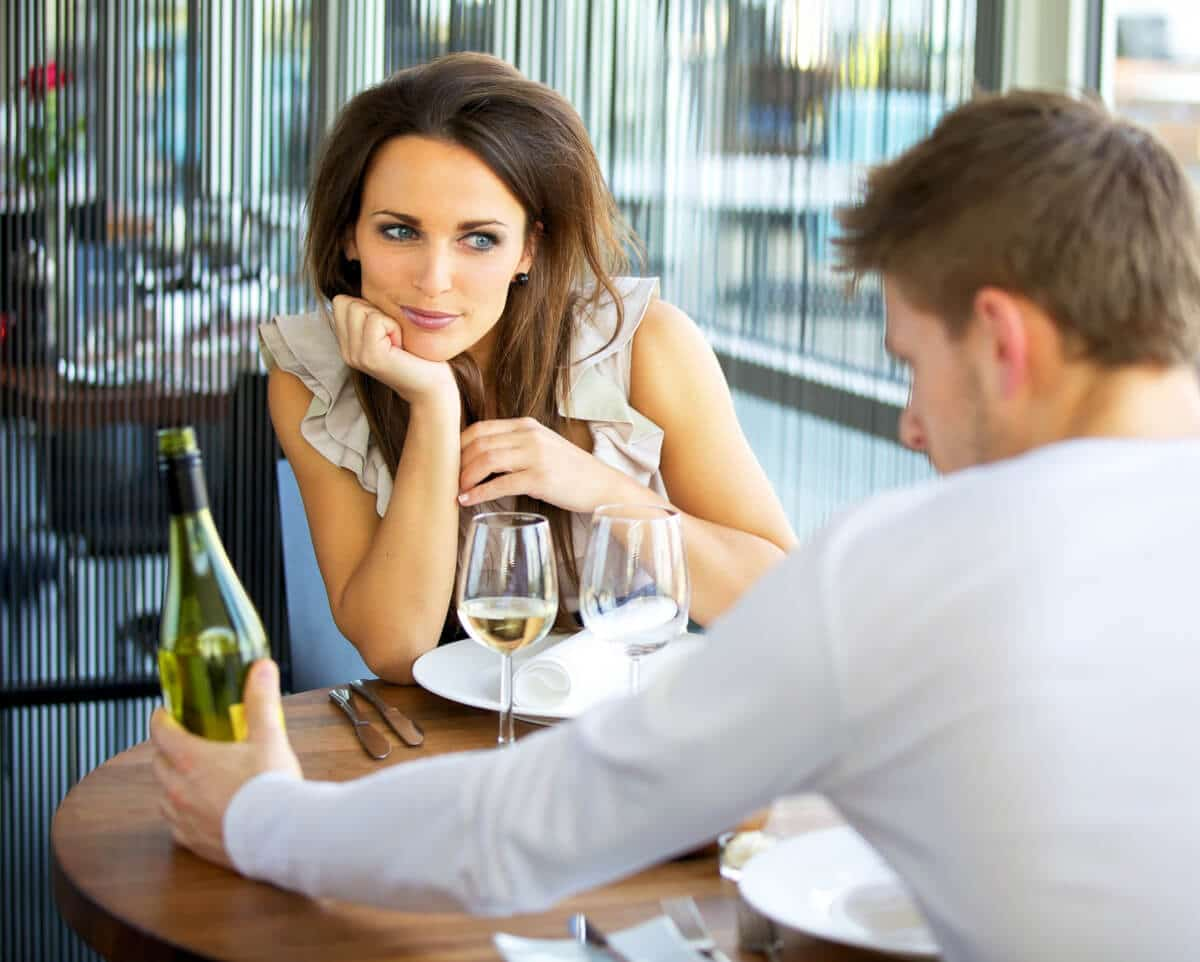 A very interested woman staring at a guy on her first date