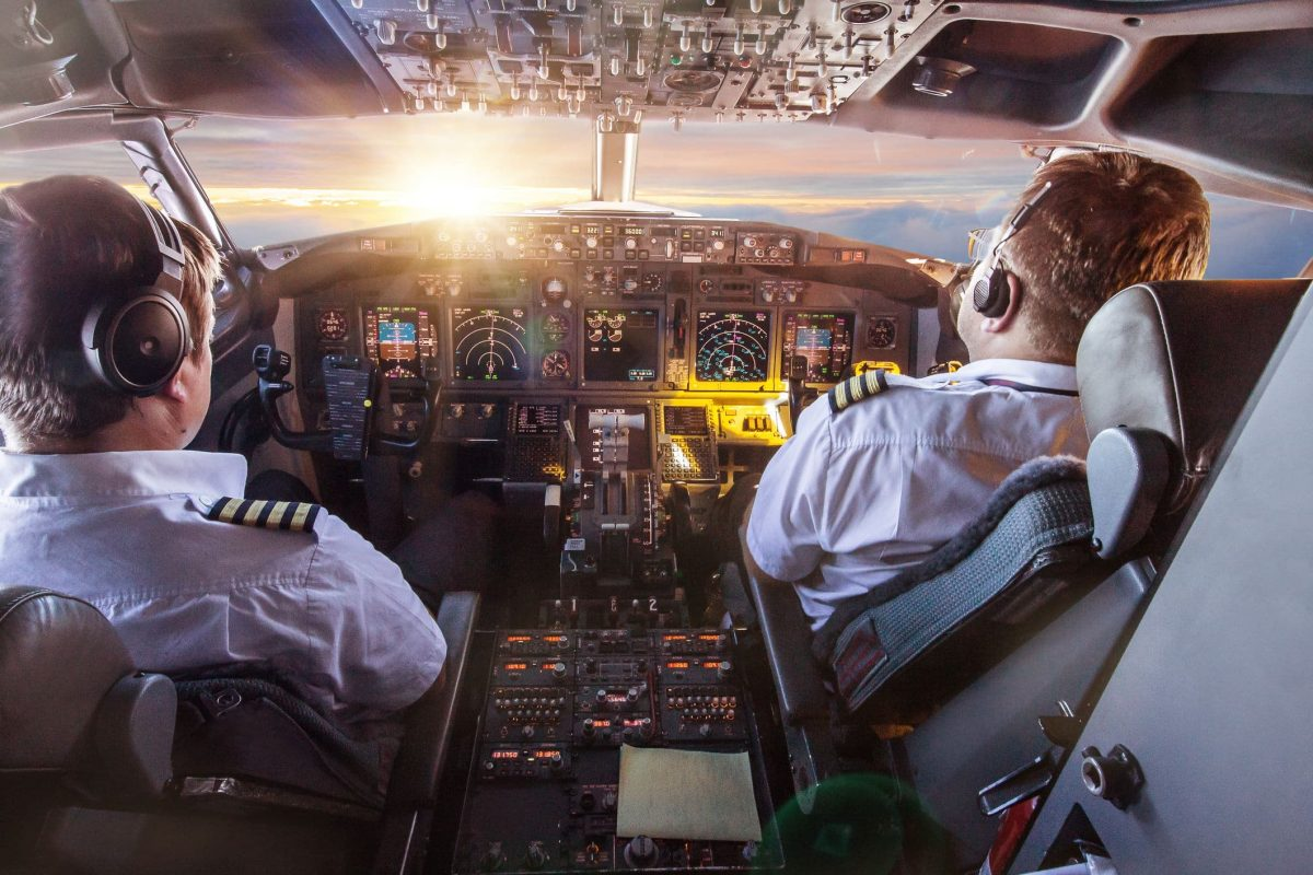 Pilot and co pilot in the cockpit during a flight with commercial airplane.