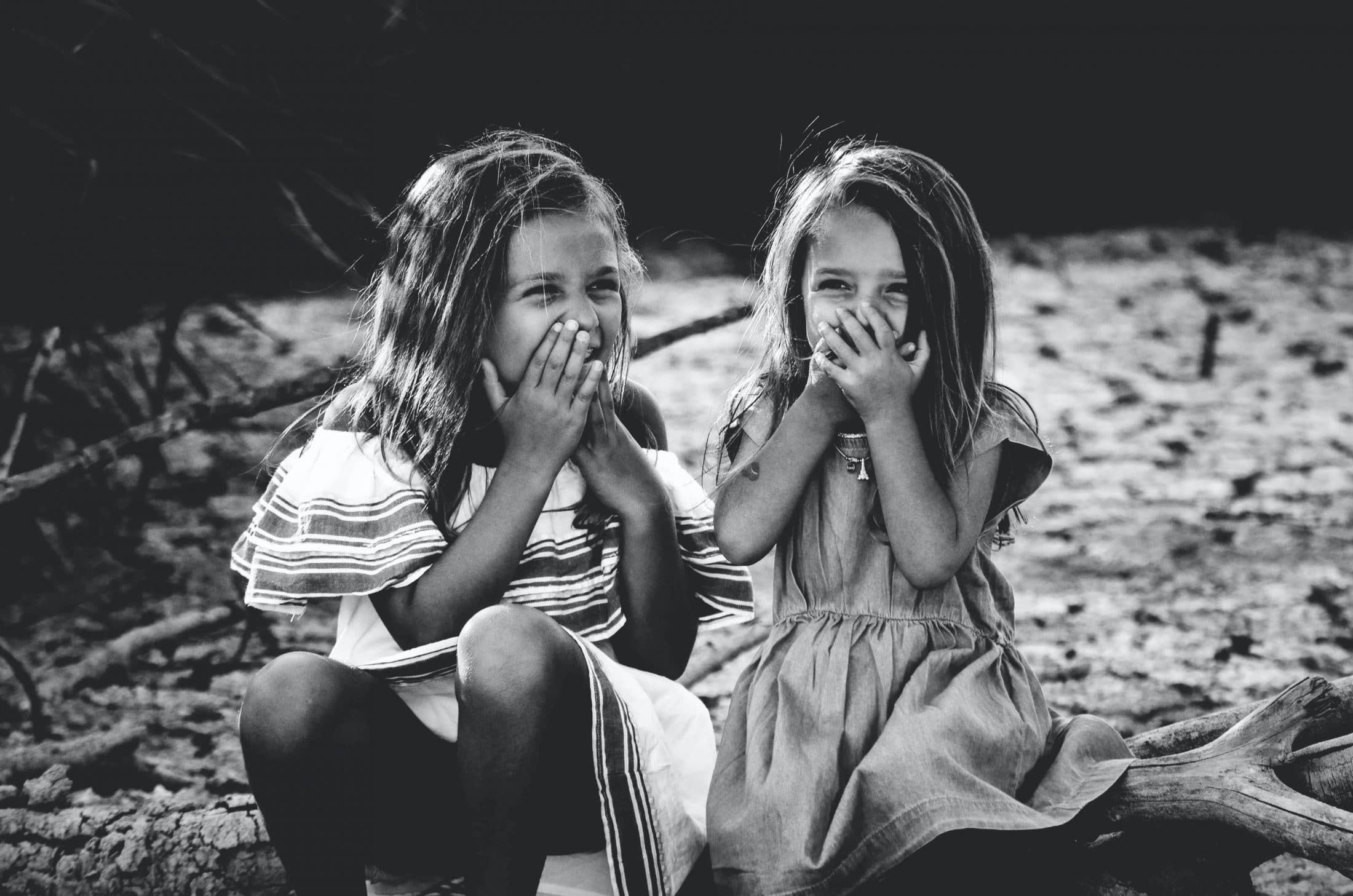 two young girls burning calories while laughing