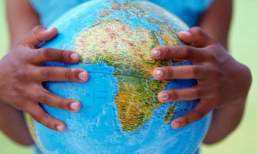 An African kid holding a globe with two hands