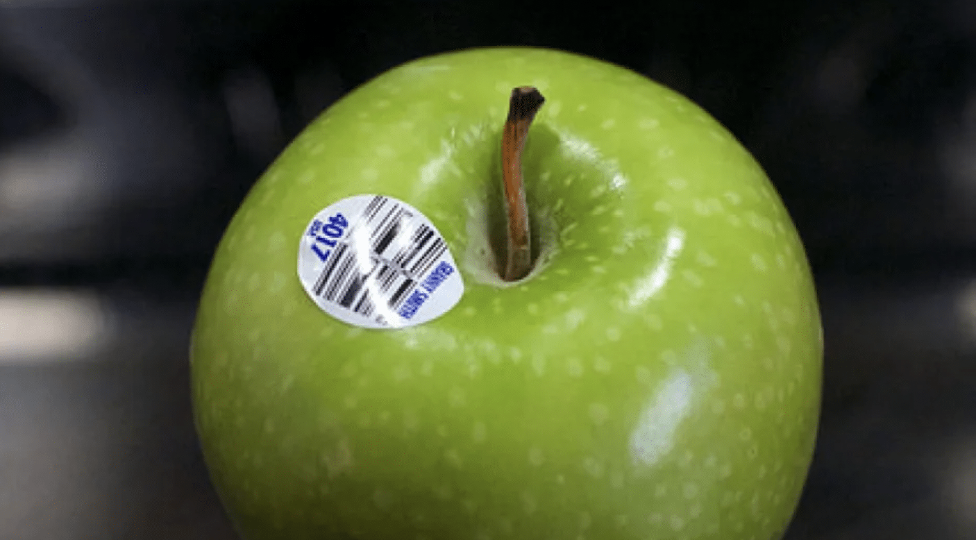 A green apple with a fruit sticker