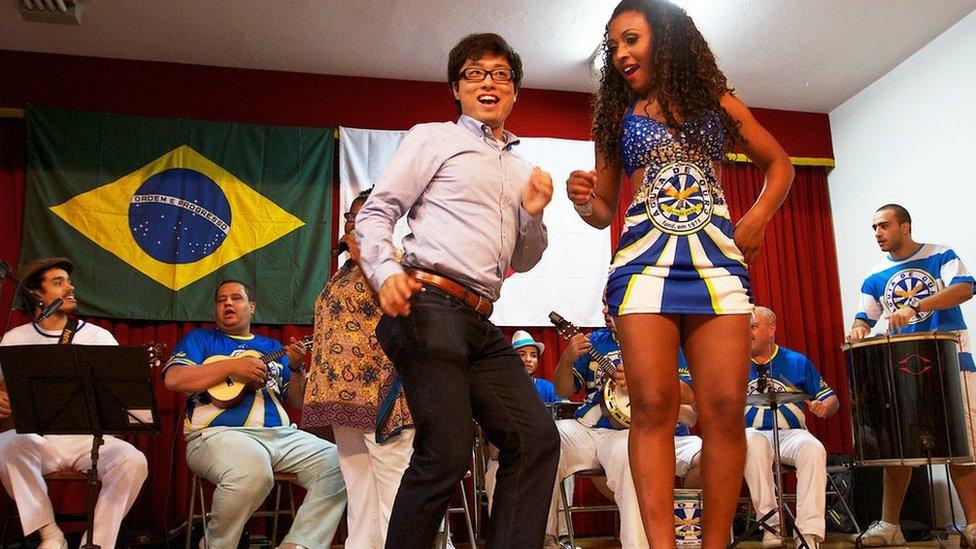 A dancing Japanese Brazilian man