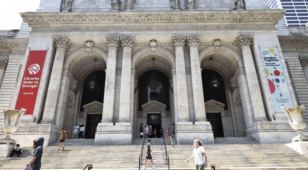People walking in front of New York Public Library