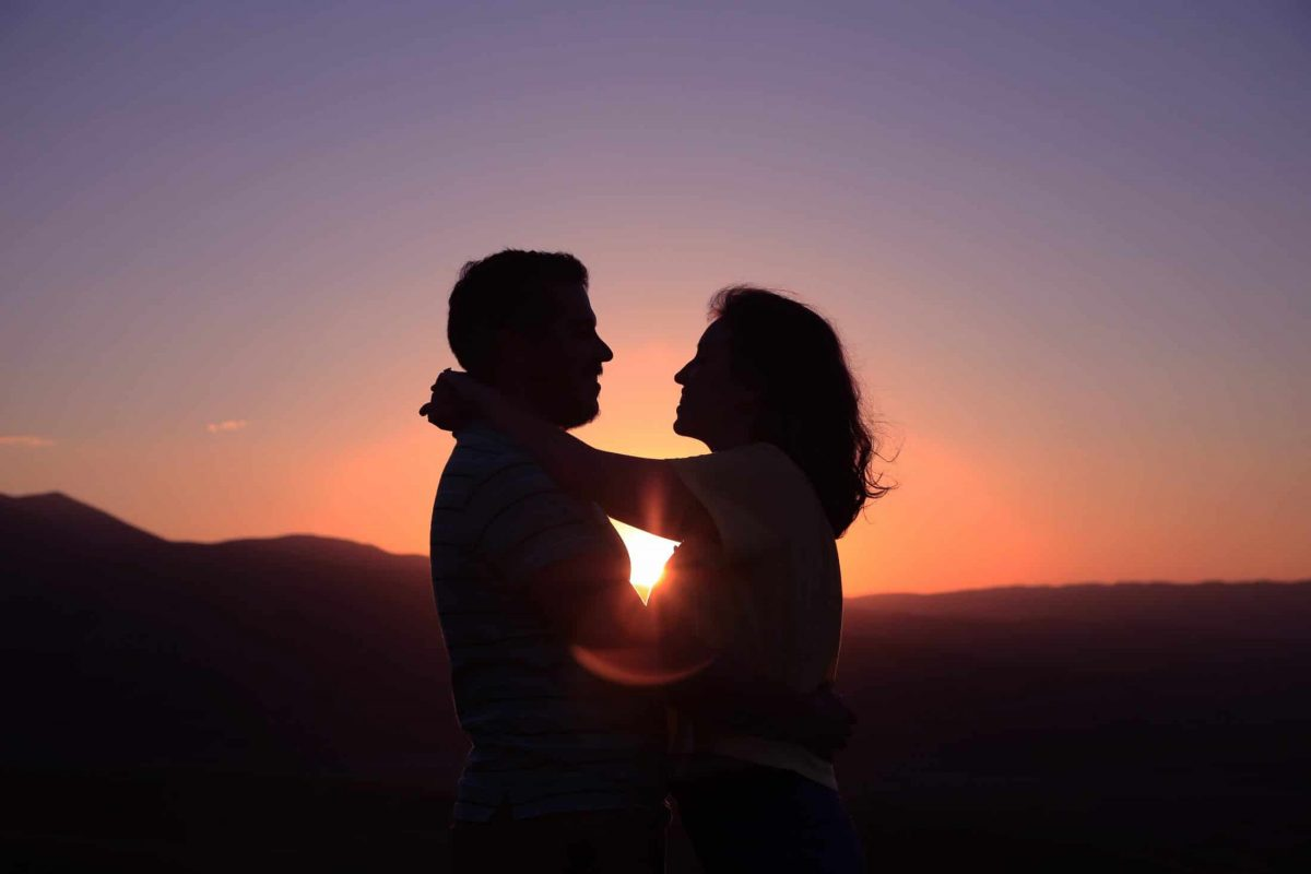 Silhouette of a man and woman with the sun in the backrground
