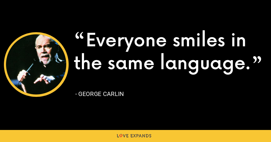 Everyone smiles in the same language. - George Carlin